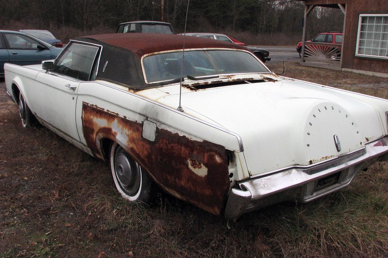 This car looked like someone had started to do some bodywork.  The left rear quarter panel looks like it had been welded in.  But judging by the level of rust, that work was done a while ago.