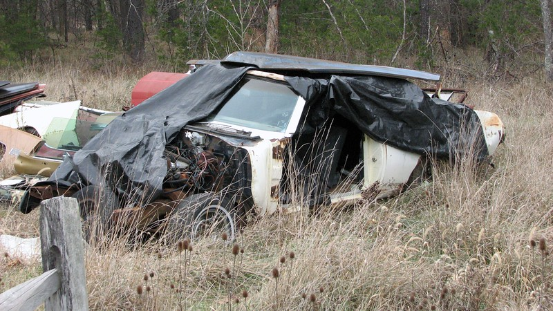 Behind everything sat a rough looking Pontiac GTO.