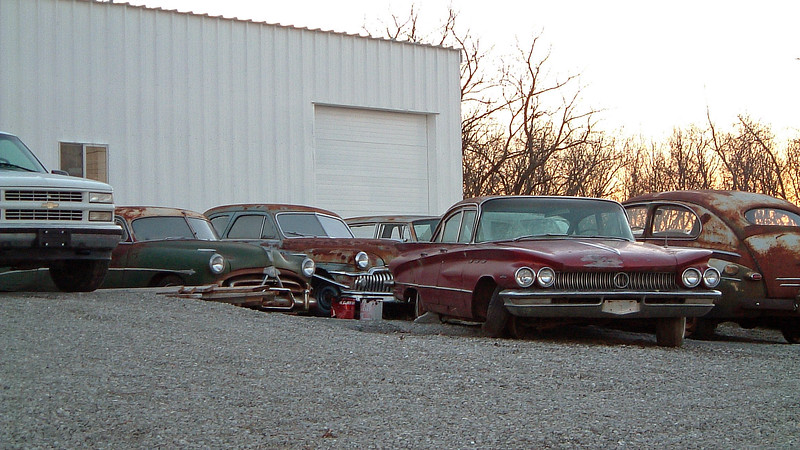 I was heading to Kansas City, Missouri on this day and spotted a car lot/restoration shop on the south side of Interstate 70 in Sweet Springs, Missouri.  The abundance of old cars on the lot got my attention, and I pulled into the place to check it out.<br /> <br /> The lot was filled with projects of all kinds in varying levels of completion.  Parked in front of the building were (L - R):  1952 Hudson Hornet, 1950 DeSoto, 1960 Buick LeSabre, and a 1946/47 Ford.