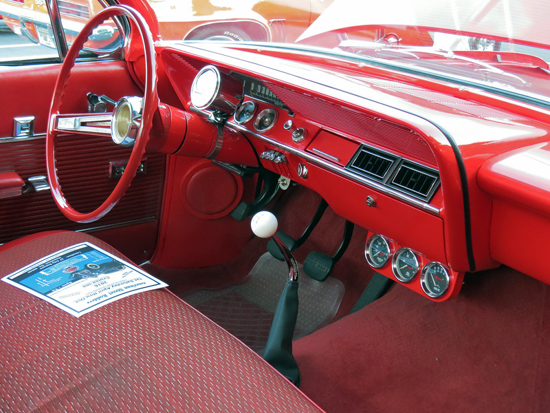 The transmission is a 5-speed manual Tremec unit.  Other than the gauges and the a/c vents, the interior retains its stock appearance.