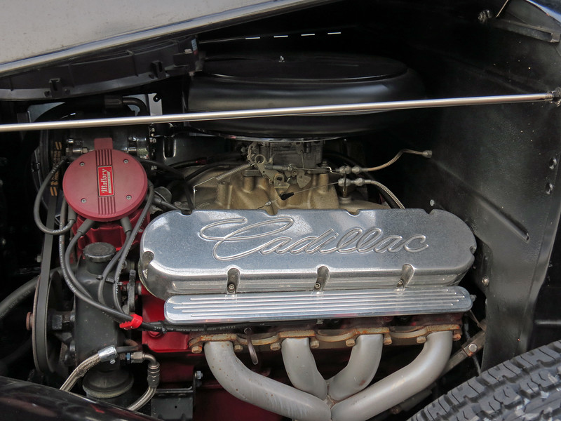 At some point, the original 95 hp 5.8L V8 was replaced with a modern Cadillac drivetrain.
