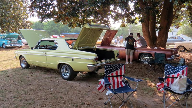 1966 Dodge Dart 270 (L) and 1957 Ford Thunderbird (R).