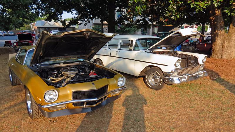 1970 Chevrolet Camaro (L), 1956 Chevrolet 210 (R).