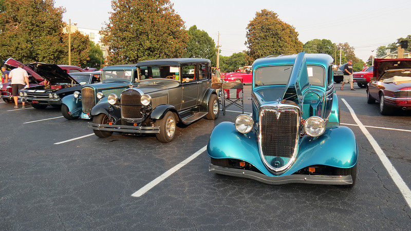 Several very nice street rods on display.