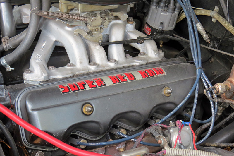 Dodge offered a 315 CID V8 as either a Poly engine (with Polyspherical cylinder heads), or as a Hemi engine (with Hemispherical cylinder heads), in 1956.  This car has the 4-bbl version of the Super Red Ram Poly engine that makes 230 hp.