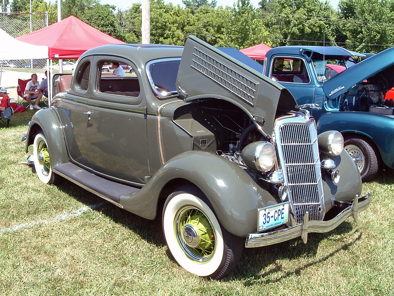 A flawlessly restored 1935 Ford Coupe.  If I had to guess, I would call this a 5-window, 2-passenger Deluxe Coupe.
