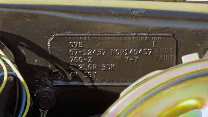 "The cowl tag confirms that this car is a legit L78 car.  Starting at the top:  <br /> 07B = Build date:  2nd week of July 1967.<br /> E = Interior paint code:  Black.<br /> 67-12437 = Style code:  67 = 1967 model year, 12437 = Camaro V8 hardtop coupe.<br /> NOR 149457 = Body code:  NOR = Norwood, Ohio assembly plant, 149457 = Fisher body number.<br /> 760-Z = Interior trim codes:  760 = black bucket seats, Z = standard Strato Bucket Seats (RPO A50) without headrest.<br /> Y-Y = Exterior paint codes:  Y = Butternut Yellow.  The fact that the same code is stamped twice indicates that the upper body and lower body colors are the same.  This also means that this car should not be equipped with a vinyl top, (even though one is present).<br /> <br /> The last two rows of the tag list the body-related options:<br /> E = Option group 1 (the ""1"" is implied):  E = Tinted glass (all glass).<br /> 2LGR = Option group 2:  L = 4-speed floor-shift transmission, G = Floor console, R = Rear seat speaker.<br /> 3DK = Option group 3:  D = Underdash courtesy lamps, K = Exterior molding group (also known as the Style Trim Group).<br /> 4K = Option group 4:  K = RPO L78 396/375 V8 engine.<br /> 5BY = Option group 5:  B = Rear bumper guards, Y = Deluxe seat belts front and rear."