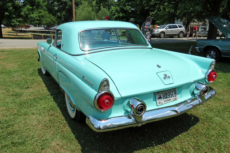 Ford introduced the two-seat Thunderbird in 1955 in response to the Chevrolet Corvette introduced in 1953.  But those cars followed different design directions and were not actually direct competitors.  <br /> <br /> Legendary GM design chief Harley Earl envisioned the Corvette to be a moderately priced competitor to European sports cars from the likes of Jaguar and Alfa-Romeo.  Ford envisioned the T-Bird to be a luxury touring car with emphasis on driver comfort, not speed and handling.  <br /> <br /> Ford was hoping to sell 10,000 Thunderbirds in 1955.  But the car was an instant success that attracted 16,155 buyers that year.
