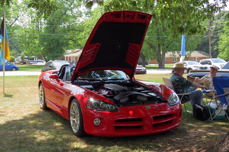 """Third generation Dodge Viper.<br /> <br /> The original Dodge Viper was introduced for the 1992 model year.  The concept was simple:  PERFORMANCE !  The idea was to breath some much-needed life into the sea of front-wheel drive economy cars that populated Dodge dealers.  A two-seat 400 hp 8.0L V10-powered rear-wheel drive rocket was enough to get people's attention.  Dodge took this one step further by offering a """"no compromise"""" performance car modeled after the legendary Shelby Cobra.  <br /> <br /> This meant several items commonly found throughout the industry were noticeably absent from the Viper's equipment list.  Things like air conditioning and power accessories were understandably not available.  Electronic nannies like traction control, abs, and airbags only added unnecessary weight and were also eliminated.  Dodge showed that they were serious when the car debuted without things like exterior door handles, key locks, side windows, and a roof, (although Dodge did include a canvas covering).<br /> <br /> Dodge phased in improvements and creature comforts over the subsequent years.  By the time the third generation Viper arrived for the 2003 model year, windows, better seats, air conditioning, and a convertible top had joined the equipment list.  The aluminum V10 had grown to 8.3L and now produced 500 hp."""
