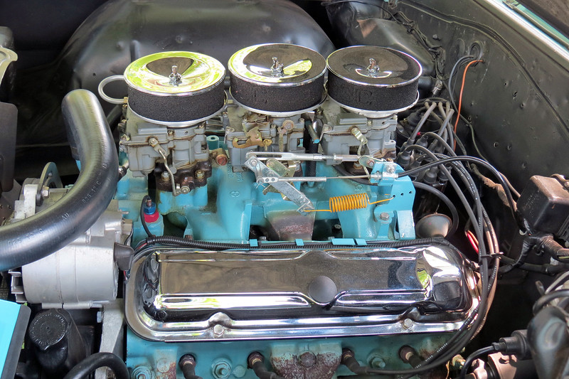 """The 389 CID V8 was available in two configurations.  The standard engine was topped with a 4-barrel carburetor and made 335 hp.  Spending an additional $116 would get buyers the optional """"Tri-Power"""" setup of three 2-barrel carburetors that made 360 hp.  This car is one of 20,547 cars produced with that option."""