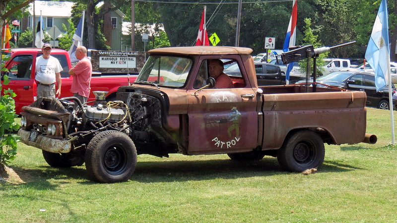 Another Rat Rod, this one being an early-60s GMC truck.  This truck sported big block power up front and a machine gun in back.
