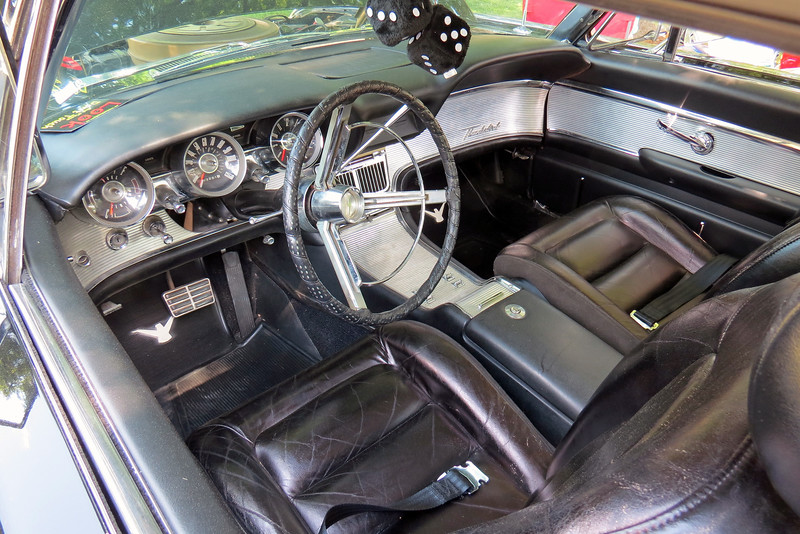 """I've always loved what Ford did with the Thunderbird's interior.  One of Ford's more interesting gadgets was the """"Swing-Away Steering Wheel.""""  As long as the transmission was in """"Park,"""" the entire steering column could be moved inboard around 10.5 inches for better ingress/egress.  The Swing-Away Steering Wheel was introduced as an option for the 1961 Thunderbird, and became standard equipment beginning in 1962."""