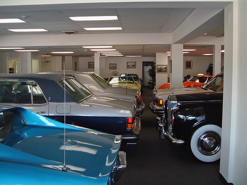 This showroom contained several Rolls-Royces and a few Corvettes.