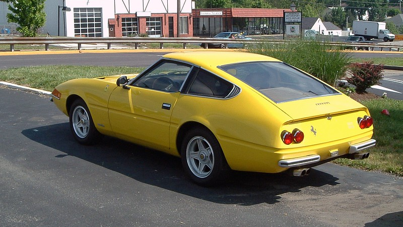 1980 Ferrari Daytona 365/GTB4 replica.  <br /> <br /> A closer inspection revealed that this car is a replica built on a Nissan chassis.  This makes sense considering one simply does not park an original 6-figure Daytona outside.  Despite its Nissan underpinnings, I'd own it !