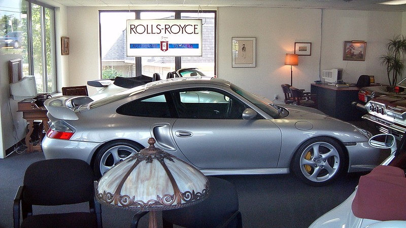 Porsche 911 GT2, 3K miles, $139,500.<br /> <br /> Of all the beautiful machinery in this showroom, the star of this show was the 996 Porsche 911 GT2, a 476 hp twin-turbo rocket that would accelerate from zero to 60 mph in 3.7 seconds.