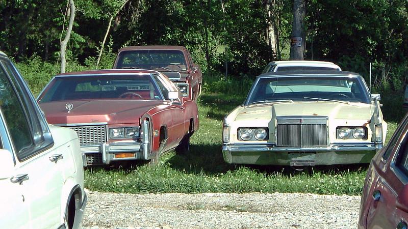 (L) 1976 Cadillac Eldorado Biarritz, (R) 1969-71 Lincoln Mark III.