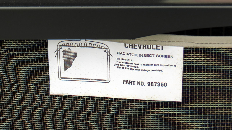 I'm not sure if the radiator insect screen is an original GM part or an aftermarket add-on.