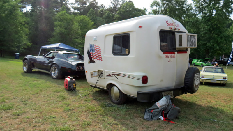 "The camper in question is a U-Haul CT13 ""Get-A-Way"" Camper.  The company known for renting trucks, trailers, and box vans also offered campers during the 1980s.  Customers could choose from the above 13-foot CT13 or the 16-foot VT16 ""Vacation Traveler"" that offered more room.  When the camper program was phased out in the early 1990s, all of the campers were sold to the public."