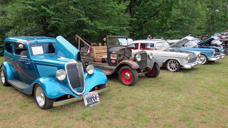 L - R:  1934 Ford 2-door sedan, 1929 Ford Model A wrecker, a pair of 1955 Chevrolet Bel Airs.
