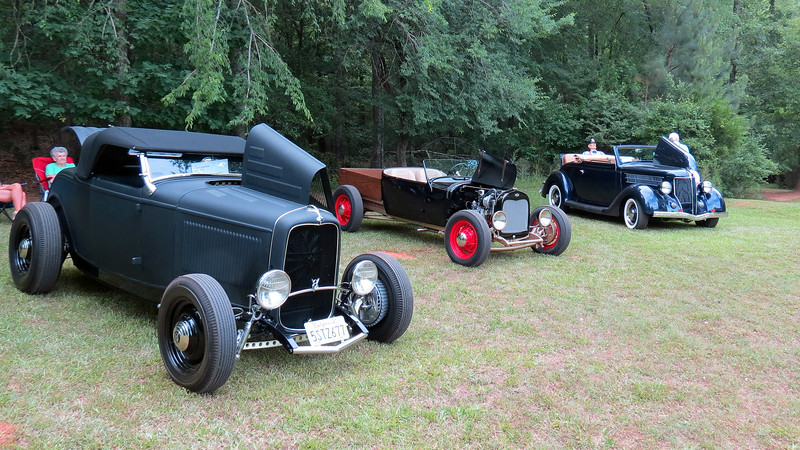 A group of three street rods (L - R):  1932 Ford roadster, 1929 Ford pickup, and 1936 Ford cabriolet.