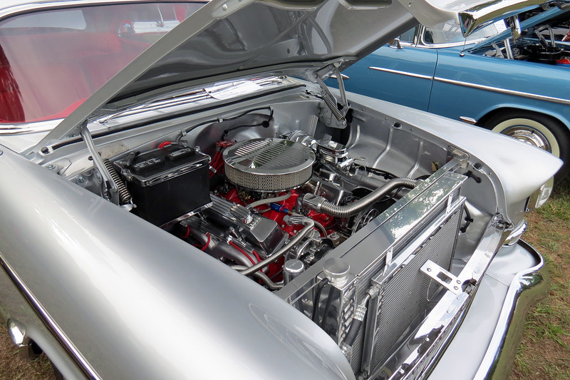 The silver car has a modified Chevrolet small block V8 under the hood.
