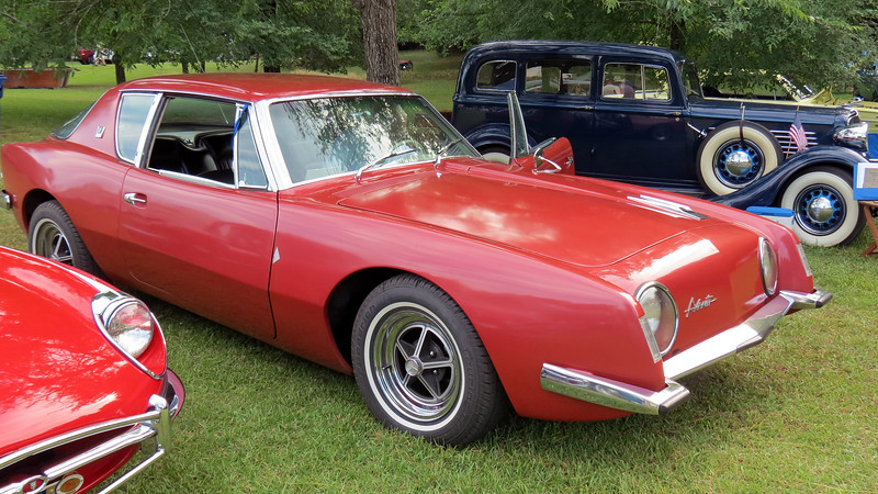 1963 Studebaker Avanti.<br /> <br /> This is a 240 hp non-supercharged R1 car with a 289 CID V-8 and 4 bbl carburetor.  Only 3,834 Avantis were produced in 1963, of which 2,282 were R1 equipped.  I managed to get a picture as it was leaving, hence the open driver's door.
