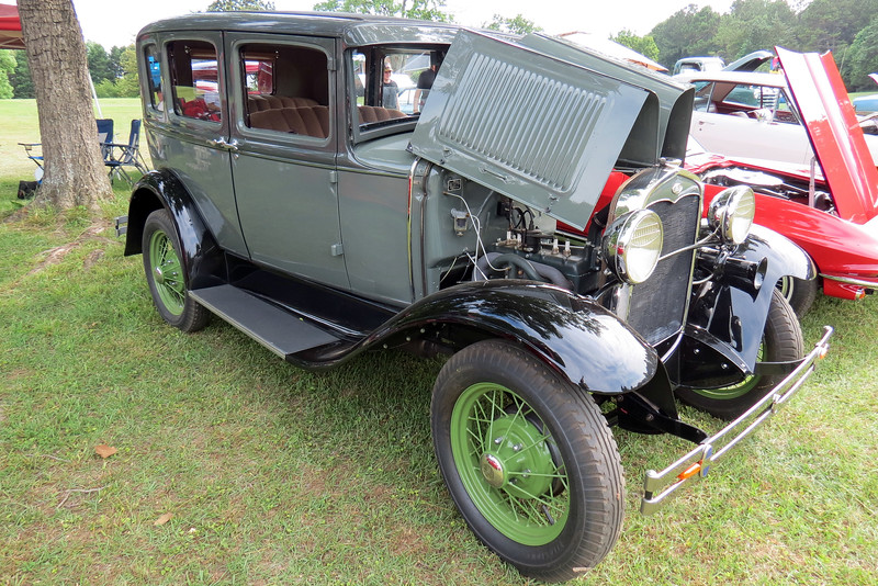 The Model A was available in more that 45 different body configurations.  Most of them, (like the tudor, phaeton, roadster, and closed-cap pickup) were made by Ford.  Other body styles, (like the cabriolet, sport coupe, open-cab pickup, town car, victoria, and station wagon), were supplied by outside coachbuilders with Murray and Briggs being the most popular.  One way to distinguish a Murray body from a Briggs body is to look at the top of the side windows.  Murray bodies feature a slight arch whereas Briggs bodies are flat.  The slight arch on the windows seen in the photo above identifies this car as a three-window four-door sedan with a Murray body.