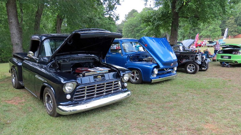 Another group of street rods (L - R):  1955 Chevrolet 3100 Series pickup, 1955 Ford F100 pickup, 1932 Ford 3-window coupe street rod.