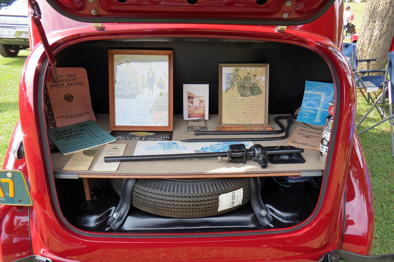 This car was displayed with numerous books and manuals as well as a complete set of tools.