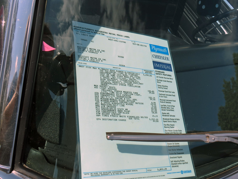 A copy of the window sticker was displayed with the car.  The option codes seen on the sticker should match those found on the fender tag.