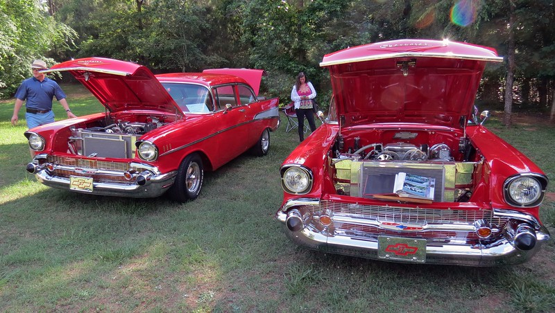 A pair of modified 1957 Chevrolets:  Bel Air 2-door sedan (L), and Bel Air Townsman wagon (R).  Both cars seem to have been modified in the same manner.