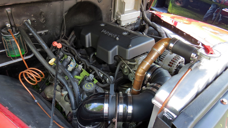 "The original inline 6-cylinder engine has been replaced by an LS1 V8 and 4L60E automatic transmission.  I give someone credit for creativity for the upper radiator ""hose"" design."
