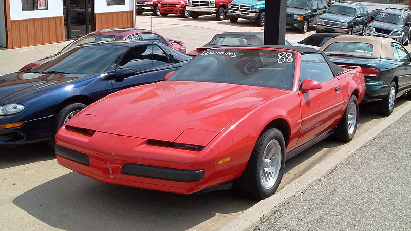 """One of my frequent destinations while living in Columbia, Missouri was the Lake of the Ozarks.  My wife and I would take a Sunday afternoon and cruise to """"The Lake"""" as it was known locally.  On this particular day, I spotted several convertibles at a small used car lot near Walmart in Osage Beach, Missouri, including this 1988 Pontiac Firebird Formula."""