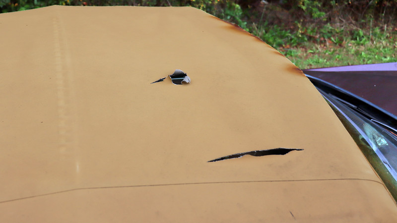 Two large holes were present in the horizontal surface of the top.