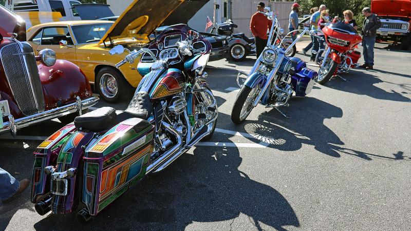 Several custom motorcycles on display.