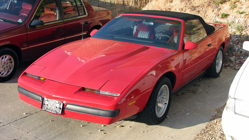 We stopped at another dealer further down the road.  We had been seeing this 1988 Pontiac Firebird Formula convertible at this small lot by Walmart in Osage Beach for quite some time.  The car's unusual color combination got my attention.