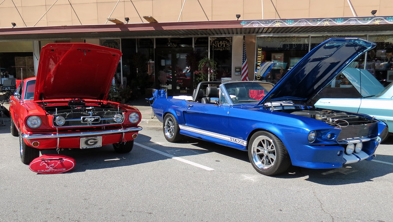 Two nice Fords- 1965 Mustang (L) and 1968 Mustang (R).