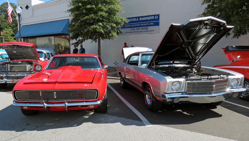 A pair of really nice Chevrolets - 1968 Camaro RS (L) and 1970 Monte Carlo (R).
