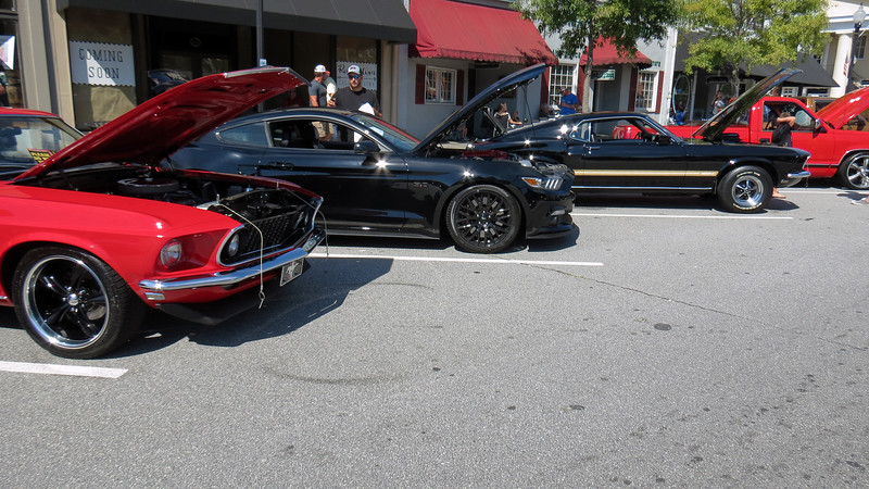 Three nice Ford Mustangs.  The middle car is a 2016 model.