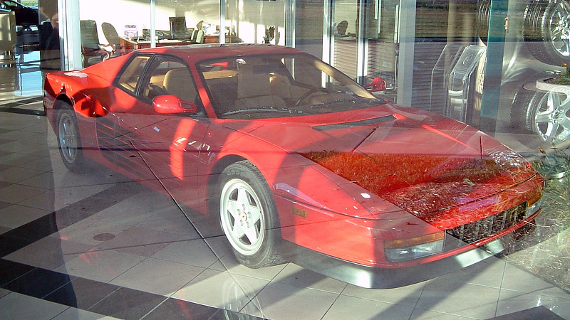Ferrari Testarossa in the showroom.  The bright sunlight and the reflection of the showroom windows confused my camera.  But you get the idea.