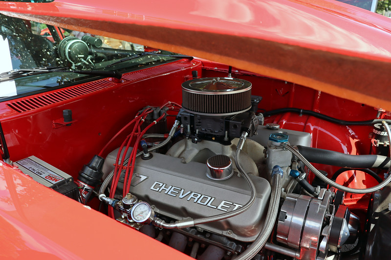 In place of the 4-cylinder engine usually seen under the hood now sits a modified 427 CID big-block V8.  Substantial modifications to the car's firewall were necessary to make the big engine fit.