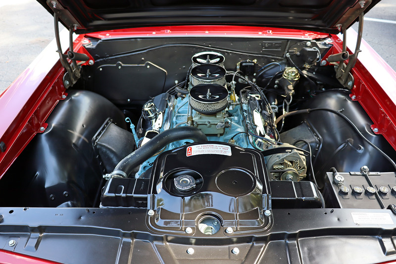 "Power comes from Pontiac's 389 CID ""Tri-Power"" V8 that makes 360 hp.  The block-off plate for the heater delete option can be seen on the left side of the firewall in the photo above."