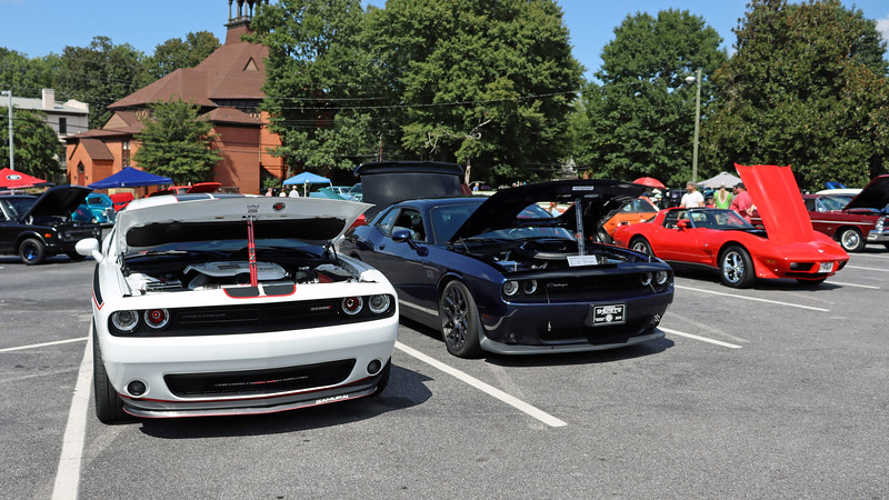A pair of new Dodge Challengers.