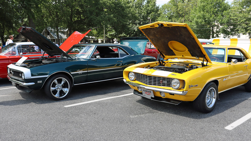 A pair of first generation Chevrolet Camaros:  1968 SS 396 (L) and 1969 Z28 tribute (R).