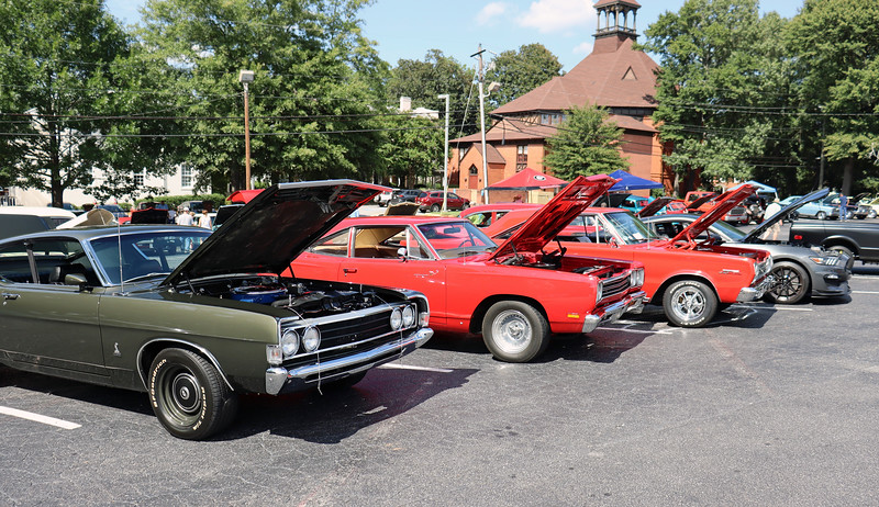 The 1968 Plymouth Road Runner in the center of the photo above represents the introductory year for the model.  The car's combination of low price and high performance made it a huge success with almost 45,000 sold that year.  This car's hinged rear side windows, (that vent outward instead of rolling down), identify it as a 2-door coupe, (as opposed to a 2-door hardtop), and one of 29,240 produced that year.