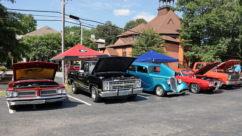 The 1962 Pontiac (far left) and 1969 Pontiac Firebird convertible (R) are regular Varsity show participants.