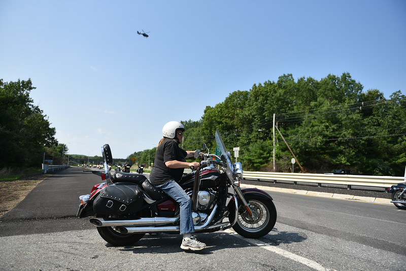 "A straggler joins the ride along with ""The Wall That Heals"" as it heads toward Crocker's Park in Fitchburg on Wednesday where it will remain for the rest of the week.  SENTINEL & ENTERPRISE JEFF PORTER"