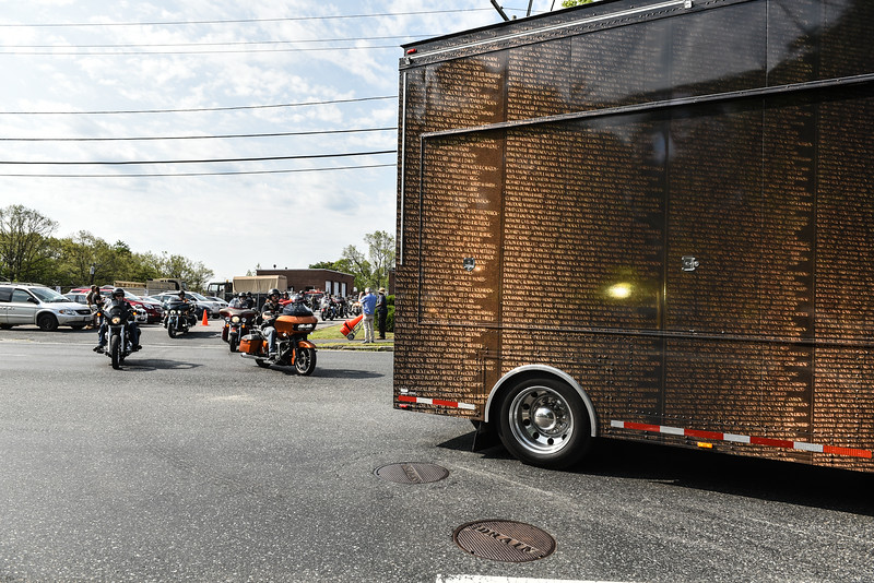 "Motorcycles and jeeps gather at the National Guard Armory in Worcester to escort ""The Wall That Heals"" to Crocker's Park in Fitchburg on Wednesday where it will remain for the rest of the week.  SENTINEL & ENTERPRISE JEFF PORTER"