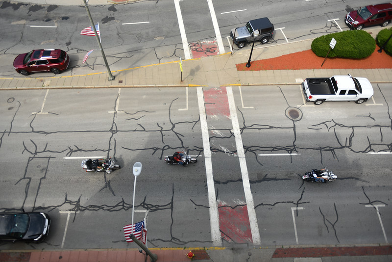 """Motorcycles and jeeps gather at the National Guard Armory in Worcester to escort """"The Wall That Heals"""" to Crocker's Park in Fitchburg on Wednesday where it will remain for the rest of the week.  SENTINEL & ENTERPRISE JEFF PORTER"""