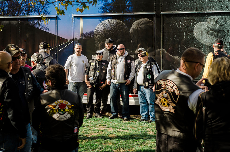 "Veterans line up to take photos as ""The Wall That Heals"" arrives at Leominster's Carter Park on Wednesday afternoon. The 250-foot replica of the Vietnam Wall traveled through the city on Wednesday morning and will be stationed at Carter Park through Sunday. SENTINEL & ENTERPRISE / Ashley Green"